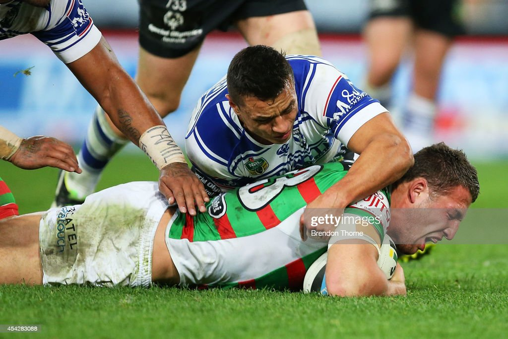 Sam Burgess of the Rabbitohs scores a try during the round 25 NRL match between the Canterbury Bulldogs and the South Sydney Rabbitohs at ANZ Stadium on August 28, 2014 in Sydney, Australia.