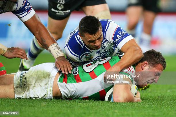Sam Burgess of the Rabbitohs scores a try during the round 25 NRL match between the Canterbury Bulldogs and the South Sydney Rabbitohs at ANZ Stadium...