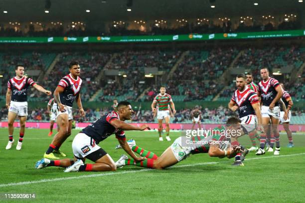 Sam Burgess of the Rabbitohs scores a try during the round one NRL match between the Sydney Roosters and the South Sydney Rabbitohs at Sydney Cricket...