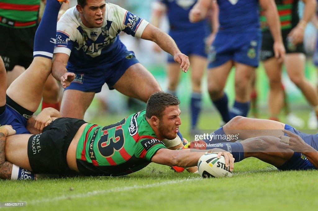 Sam Burgess of the Rabbitohs scores a try during the round seven NRL match between the South Sydney Rabbitohs and the Canterbury-Bankstown Bulldogs at ANZ Stadium on April 18, 2014 in Sydney, Australia.