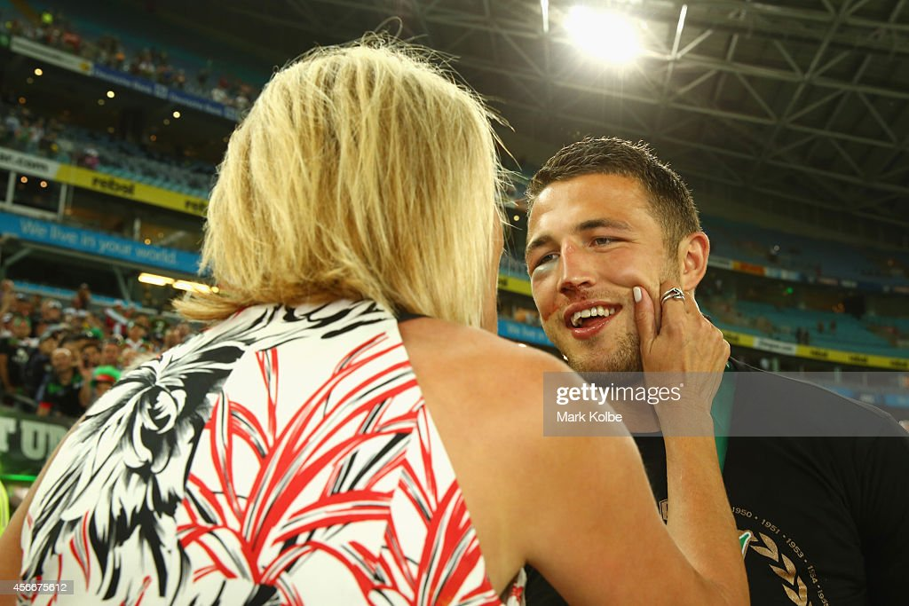 Sam Burgess of the Rabbitohs speaks with his mother Julie Burgess after victory during the 2014 NRL Grand Final match between the South Sydney Rabbitohs and the Canterbury Bulldogs at ANZ Stadium on October 5, 2014 in Sydney, Australia.