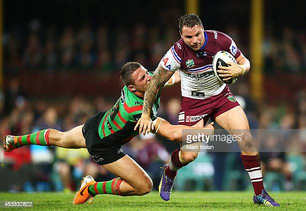 Sam Burgess of the Rabbitohs tackles Anthony Watmough of the Eagles during the round 22 AFL match between the South Sydney Rabbitohs and the Manly...