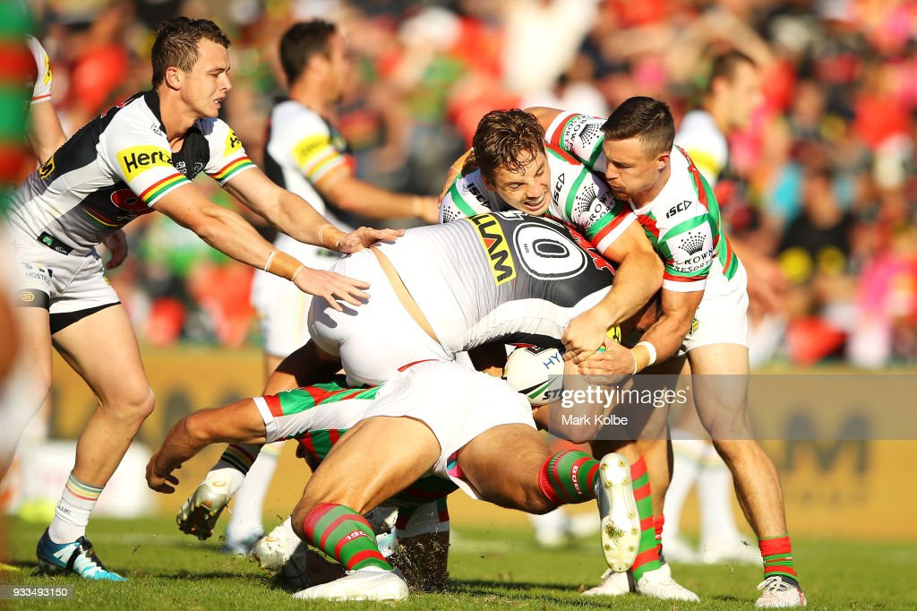 Sam Burgess of the Rabbitohs tackles Reagan Campbell-Gillard of the Panthers during the round two NRL match between the Penrith Panthers and the South Sydney Rabbitohs at Penrith Stadium on March 17, 2018 in Sydney, Australia.