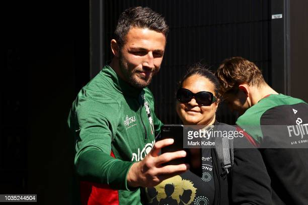 Sam Burgess poses for a selfie with a Rabbitohs supporter after speaking to the press during a South Sydney Rabbitohs NRL media opportunity at...