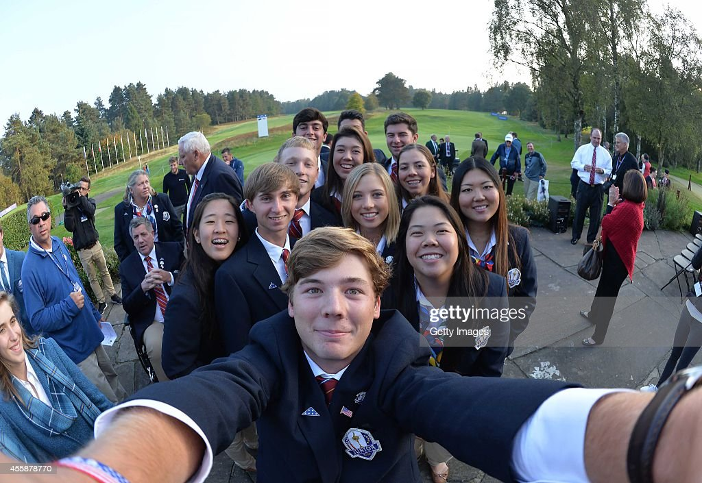 Sam Burns of Team USA asks to borrow a camera for a Selfie with his team mates, during the Opening Ceremony of the 2014 Junior Ryder Cup at Blairgowrie Golf Club on September 21, 2014 in Perth, Scotland.