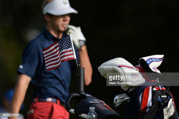 Sam Burns of Team USA with the USA flag flying during the first round mixed four balls at the 2014 Junior Ryder Cup at Blairgowrie Golf Club on...
