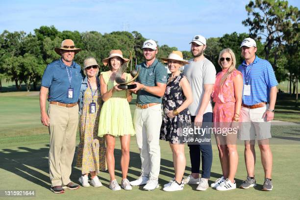 Sam Burns of the United States celebrates with the trophy and family members after winning during the final round of the Valspar Championship on the...