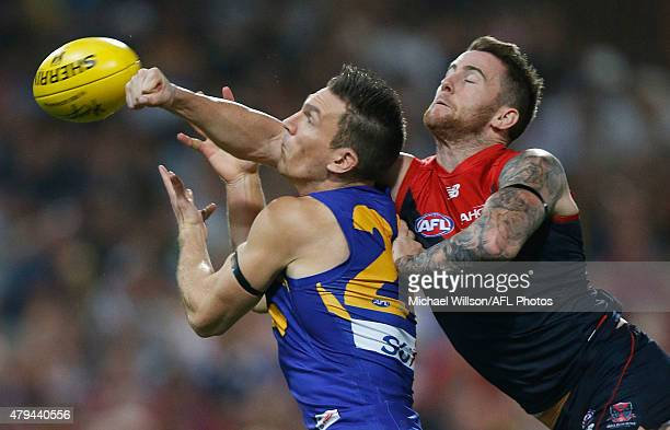 Sam Butler of the Eagles and Jeremy Howe of the Demons compete for the ball during the 2015 AFL round 14 match between the Melbourne Demons and the...
