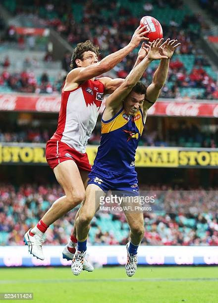 Sam Butler of the Eagles is challenged by Kurt Tippett of the Swans during the round five AFL match between the Sydney Swans and the West Coast...