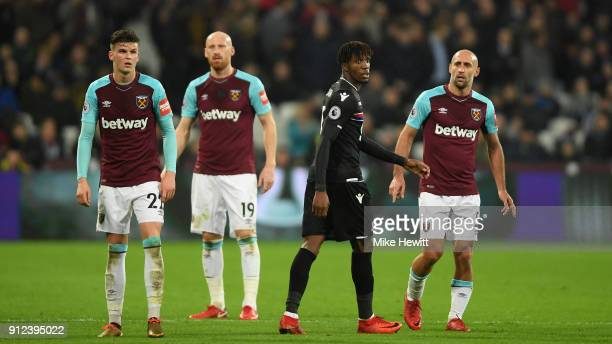 Sam Byram James Collins and Pablo Zabaleta of West Ham United keep an eye on Wilfried Zaha of Crystal Palace during the Premier League match between...