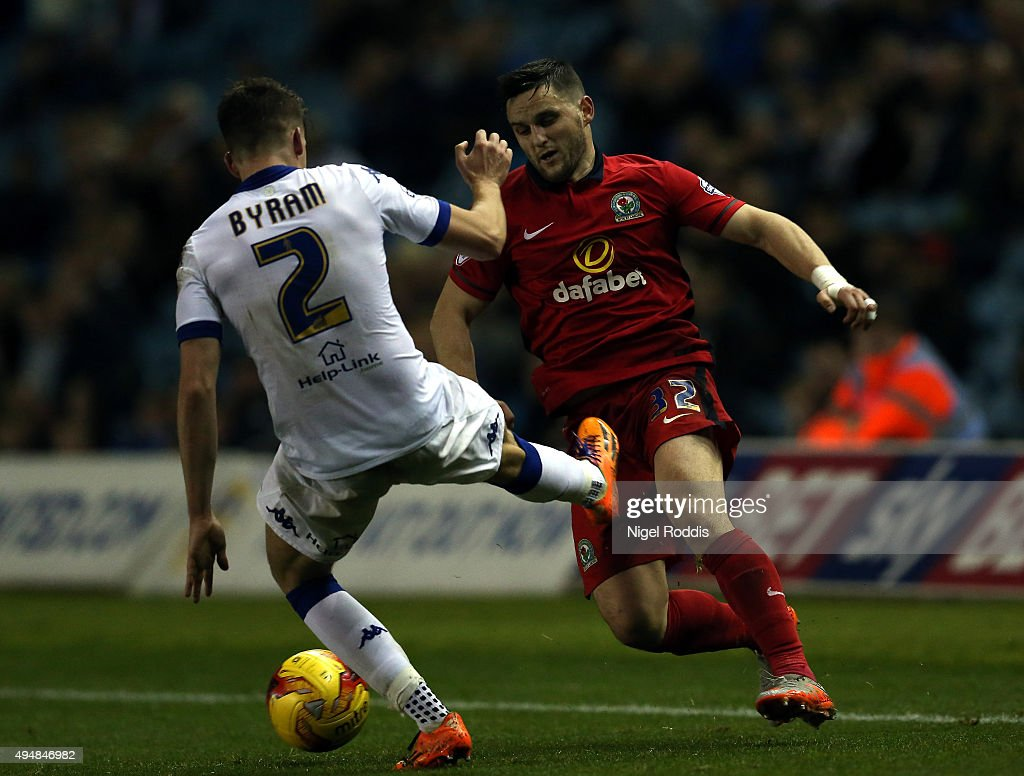 Sam Byram (L) of Leeds United challenges Craig Conway of Blackburn Rovers during the Sky Bet Championship match between Leeds United and Blackburn Rovers on October 29, 2015 in Leeds, United Kingdom.