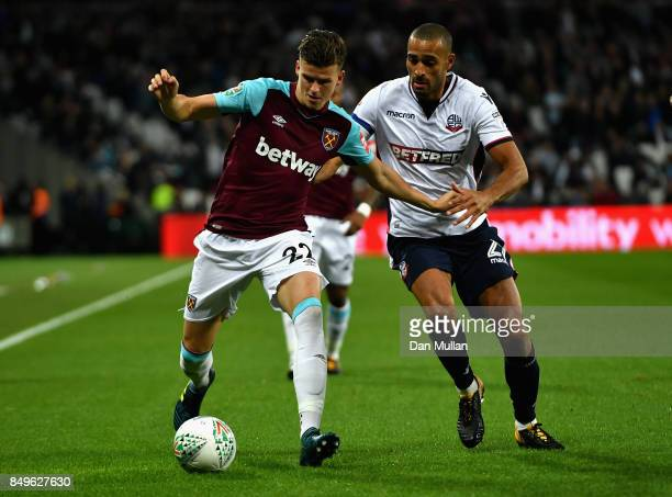 Sam Byram of West Ham United and Darren Pratley of Bolton Wanderers battle for possession during the Carabao Cup Third Round match between West Ham...