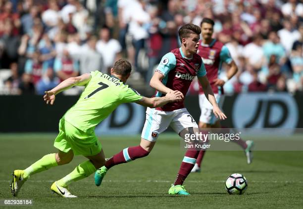 Sam Byram of West Ham United is put under pressure from James Milner of Liverpool during the Premier League match between West Ham United and...