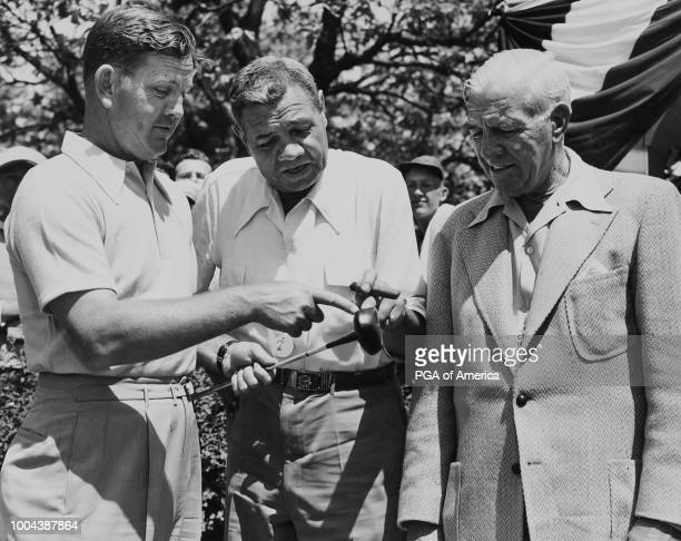 Sam Byrd and Babe Ruth have a social conversation looking at a golf club'n