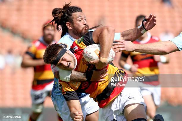 Sam Caird of Waikato is tackled by Rene Ranger of Northland during the Mitre 10 Cup Championship Semi Final match between Waikato and Northland at...