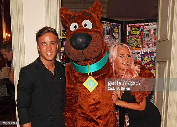 Sam Callahan and Chloe Paige pose with ScoobyDoo at the press night after party for ScoobyDoo Live Musical Mysteries at The London Palladium on...