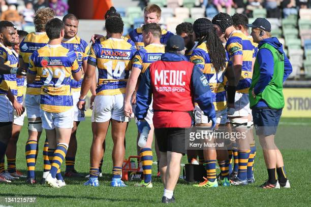 Sam Cane carries water as Bay of Plenty players huddle during the round five Bunnings NPC, and Ranfurly Shield match between Hawke's Bay and Bay of...