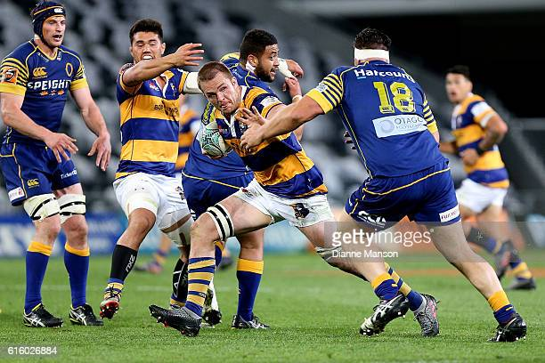 Sam Cane of Bay of Plenty fends off Josh Hohneck of Otago during the Mitre 10 Cup Championship Semi Final between Otago and Bay of Plenty on October...
