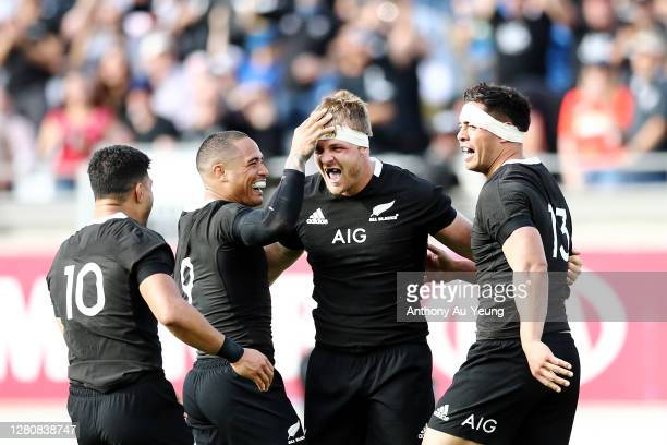 Sam Cane of the All Blacks celebrates with teammates after scoring a try during the Bledisloe Cup match between the New Zealand All Blacks and the...