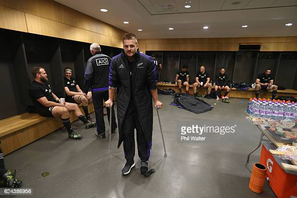 Sam Cane of the All Blacks is on crutches in the dressing room following the international rugby match between Ireland and the New Zealand All Blacks...