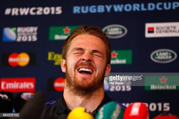 Sam Cane of the All Blacks laughs at a joke during a New Zealand All Blacks media session at Oatlands Park on October 26 2015 in Bagshot United...