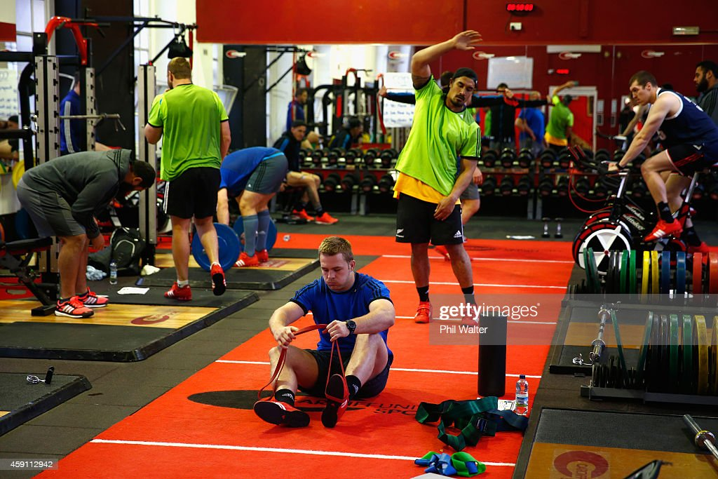 Sam Cane of the All Blacks stretches during a New Zealand All Blacks Gym session at the Cardiff University Strength and Conditioning Centre on November 17, 2014 in Cardiff, Wales.