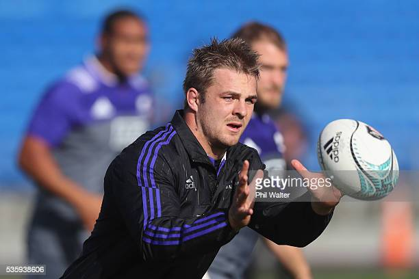 Sam Cane of the All Blacks takes a pass during a New Zealand All Blacks training session at Trusts Stadium on May 31 2016 in Auckland New Zealand