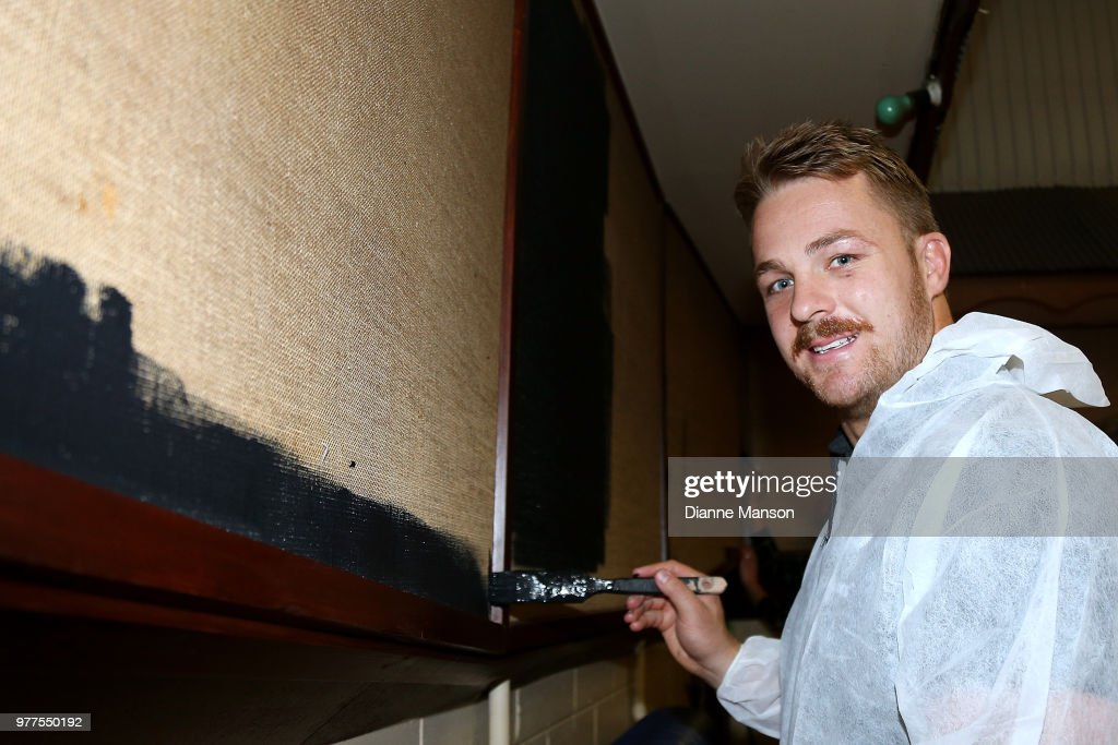 Sam Cane of the All Blacks volunteers to help paint a wall at the Pirates Rugby Club during an New Zealand All Blacks community activity on June 18, 2018 in Dunedin, New Zealand.