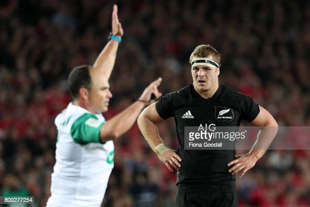 Sam Cane of the All Blacks with the referee Jaco Peyper during the Test match between the New Zealand All Blacks and the British Irish Lions at Eden...