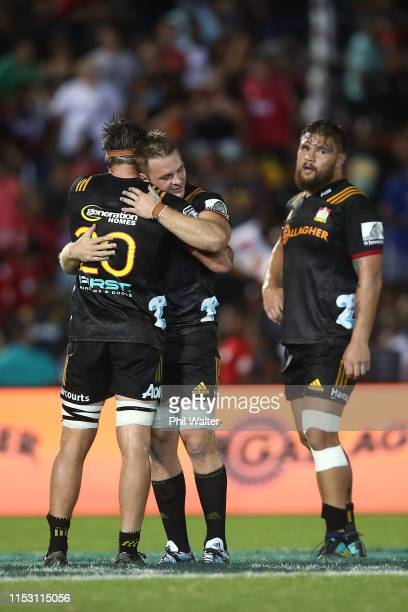 Sam Cane of the Chiefs hugs Mitchell Jacobson following the round 16 Super Rugby match between the Chiefs and the Crusaders at the ANZ National...