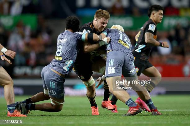 Sam Cane of the Chiefs is tackled during the round 4 Super Rugby Aotearoa match between the Chiefs and the Hurricanes at FMG Stadium Waikato on July...
