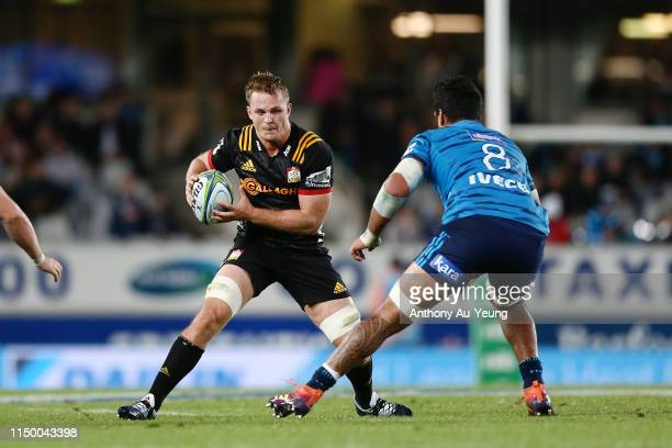 Sam Cane of the Chiefs makes a run at Akira Ioane of the Blues during the round 14 Super Rugby match between the Blues and the Chiefs at Eden Park on...
