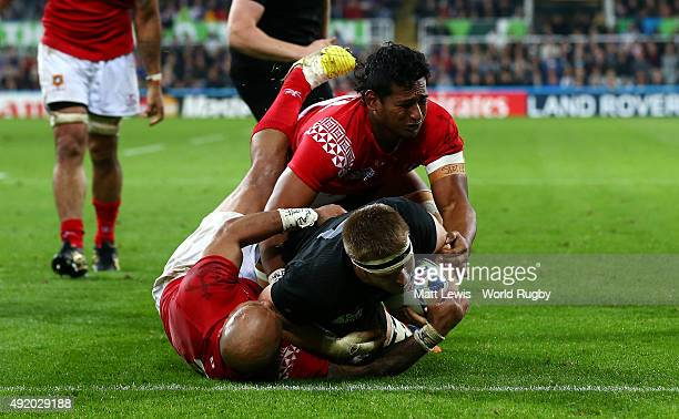 Sam Cane of the New Zealand All Blacks scores their sixth try during the 2015 Rugby World Cup Pool C match between New Zealand and Tonga at St James'...