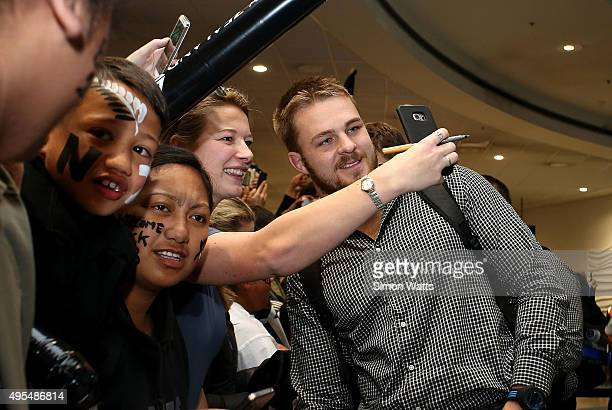 Sam Cane of the New Zealand All Blacks signs autographs at the Auckland International Airport on November 4 2015 in Auckland New Zealand The All...
