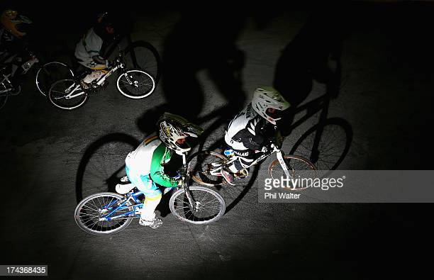 Sam Cannon of New Zealand and Emanuele Giannini of Bolivia compete in the 5 6 year boys during day two of the UCI BMX World Championships at Vector...