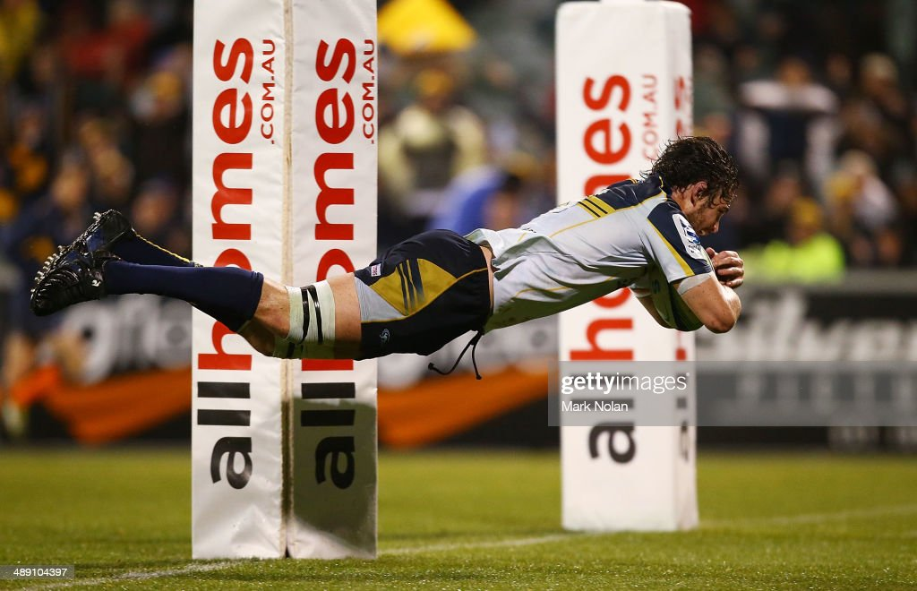 Sam Carter of the Brumbies dives to score a try during the round 13 Super Rugby match between the Brumbies and the Sharks at Canberra Stadium on May 10, 2014 in Canberra, Australia.