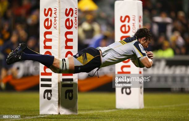 Sam Carter of the Brumbies dives to score a try during the round 13 Super Rugby match between the Brumbies and the Sharks at Canberra Stadium on May...