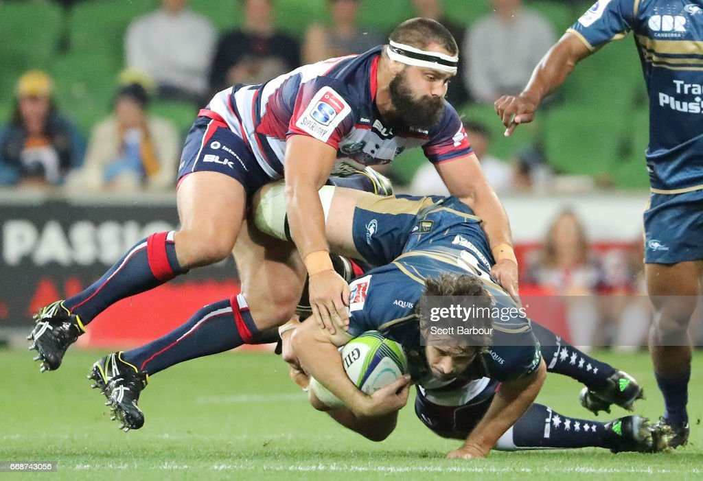 Sam Carter of the Brumbies is tackled by James Hanson of the Rebels during the round eight Super Rugby match between the Rebels and the Brumbies at AAMI Park on April 15, 2017 in Melbourne, Australia.