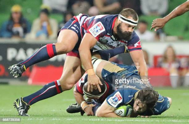 Sam Carter of the Brumbies is tackled during the round eight Super Rugby match between the Rebels and the Brumbies at AAMI Park on April 15 2017 in...