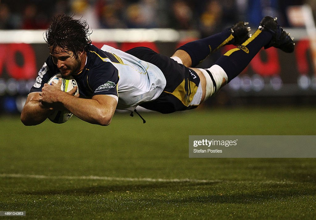 Sam Carter of the Brumbies scores a try during the round 13 Super Rugby match between the Brumbies and the Sharks at Canberra Stadium on May 10, 2014 in Canberra, Australia.