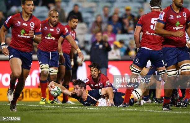 Sam Carter of the Brumbies scores a try during the round 8 Super Rugby match between the Brumbies and the Reds at University of Canberra Oval on...