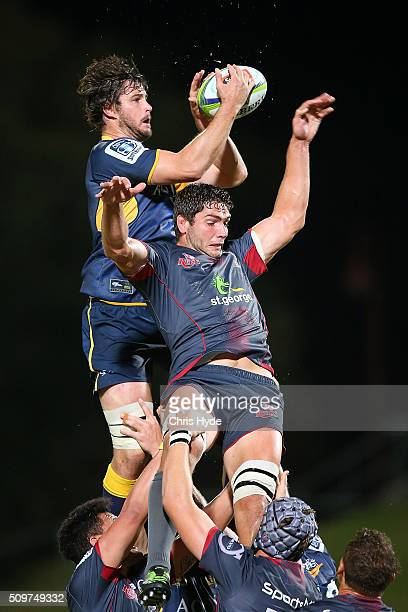 Sam Carter of the Brumbies takes the line out over Rob Simmons of the Reds during the Super Rugby PreSeason match between the Reds and the Brumbies...