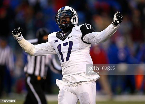 Sam Carter of the TCU Horned Frogs celebrates after holding the Kansas Jayhawks on third down in third quarter at Memorial Stadium on November 15,...