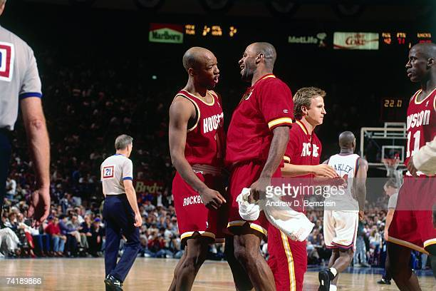 Sam Cassell and Mario Elie of the Houston Rockets chest bump each other during Game Three of the NBA Finals played on June 12 1994 at Madison Square...