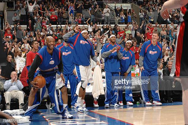 Sam Cassell Corey Maggette James Singleton Daniel Ewing and Paul Davis of the Los Angeles Clippers get pumped up after a made shot against the...