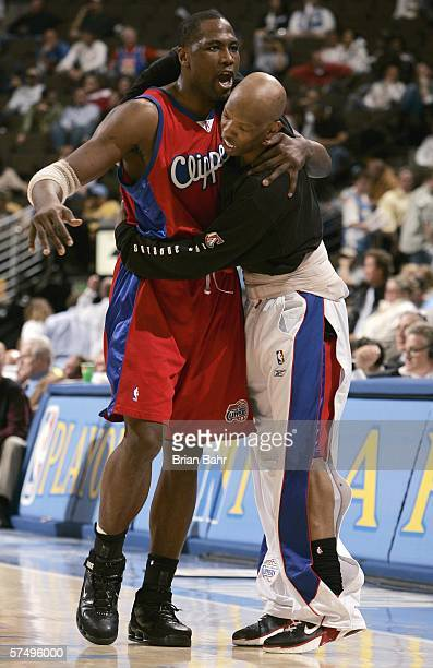 Sam Cassell of the Los Angeles Clippers hugs teammate Elton Brand after their win over the Denver Nuggets in game four of the Western Conference...