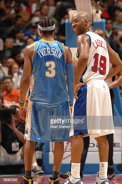Sam Cassell of the Los Angeles Clippers jokes with Allen Iverson of the Denver Nuggets during the fourth quarter of their game at Staples Center on...