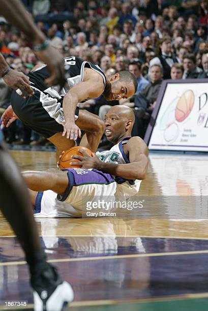 Sam Cassell of the Milwaukee Bucks is defended by Tony Parker of the San Antonio Spurs during the game at Bradley Center on March 11 2003 in...