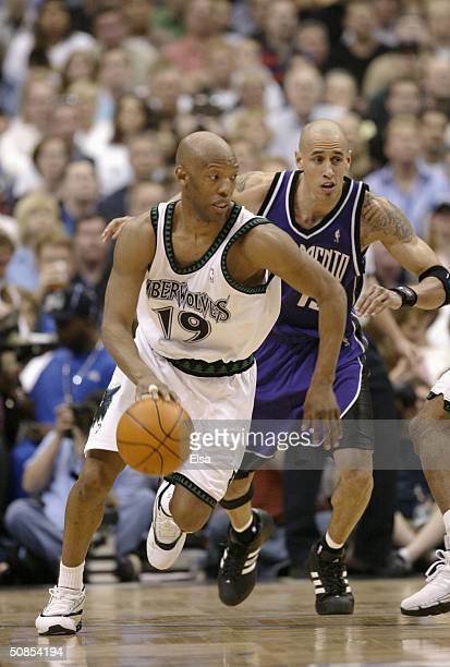 Sam Cassell of the Minnesota Timberwolves advances the ball on the dribble as Doug Christie of the Sacramento Kings gives chase in Game Two of the...