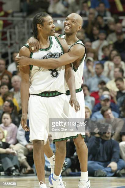 Sam Cassell of the Minnesota Timberwolves hugs his teammate Latrell Sprewell at the game against the Chicago Bulls on December 30, 2003 at Target...